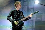 Matt Bellamy, Sänger und Gitarrist von Muse, bei einem Konzert in München. (Bild: Keystone)