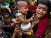 Myanmar will den vertriebenen Rohingyas zu Hilfe kommen (Archiv) (Bild: KEYSTONE/AP/BERNAT ARMANGUE)