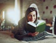 Wer dicke Bücher liest, liegt voll im medialen und gesellschaftlichen Trend. (Bild: Getty)