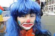 «Weil das Motto vom Chnöpfliumzug Zirkus heisst, mache ich als Clown mit. Es ist toll, dass wir Kinder einen Umzug machen dürfen, wir haben mega den Plausch.» Livia Peter, Rotkreuz (Bild: Christian H. Hildebrand / Neue ZZ)