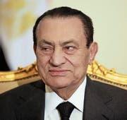 Gelder dieser ehemaligen afrikanischen Machthaber waren oder sind auf Schweizer Konten eingefroren. Oben, von links: Muammar al-Gaddafi (Libyen), Laurent Gbagbo (Elfenbeinküste). Unten, von links: Ben Ali (Tunesien) sowie Hosni Mubarak (Ägypten). (Bilder: EPA/AP)