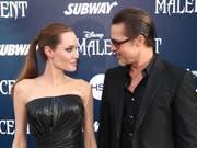 Das Paar Jolie-Pitt an einer Premierenfeier im Jahr 2014 (Bild: KEYSTONE/AP Invision/MATT SAYLES)