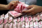 Die Behörden haben die illegalen Machenschaften der bisher grösste Untergrundbank Chinas aufgedeckt. (Bild: Chinatopix via AP)
