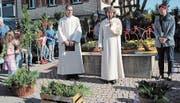 Pfarreileiterin Ingrid Krucker und Pastoralassistent Toni Ziegler stimmen tiefsinnigen Worten in den Palmsonntag-Gottesdienst ein. (Bild: Bea Näf)