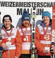 Das Siegerfoto der Schweizer Meisterschaften Riesenslalom in Malbun: Marco Giger (2.), Rémi Cuche (1.) und Nick Spörri (3.). (Bild: pd)