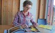 In einem Fotobuch hat Christina Frei die Erinnerungen, die sich in zwölf Jahren Sunsingers angesammelt haben, zu Papier gebracht. (Bild: Remo Zollinger)