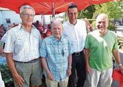 Fotokünstler und Vernissageredner vereint (von links): Röbi Kuster, Hans Spirig, Gemeinderat Patrick Spirig und Fredi Durot. (Bild: Ulrike Huber)