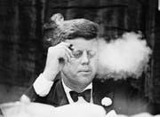 Soll sich 1962 kurz vor den Sanktionen mit 1000 kubanischen Zigarren eingedeckt haben: US-Präsident John F. Kennedy. (Bild: Bettmann Archive)