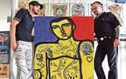 Arbeiten ausgezeichnet zusammen: Der Pop-Art-Künstler Marco De Lucca (links) und der bekannte Rheinecker Tattoo-Artist Dischy. (Bild: pd)