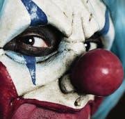 Haben leicht lachen, erschrecken aber alle Leute: Horror-Clowns erlauben sich perfide Spässe. (Bild: Fotolia)