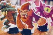 Sieht aus wie in einem japanischen B-Movie, ist aber ein Spiel: In «King of Tokyo» kämpft man mit Monstern gegen seine Mitspieler. (Bilder: pd)