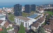Das Stadtwald-Quartier mit neuen Hochhäusern, neuem Wohn-/Gewerbehaus (im Vordergrund) und umgebauter Alcan-Halle mit Glasdach. (Bild: Hardy Buob)