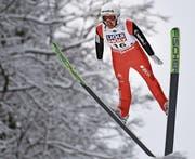 Simon Ammann ist wie erwartet der beste Schweizer. (Bild: Philipp Guelland/EPA)
