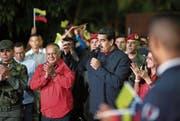 Venezuelas Präsident Nicolás Maduro bei einer Rede nach dem Sieg seiner Partei am Sonntag. (Bild: EPA (Caracas))