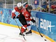 Da war die Welt noch in Ordnung: Anja Stiefel an den Olympischen Spielen in Sotschi im Spiel gegen Russland. (Bild: Martin Rose/Getty)