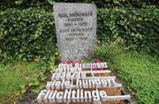 Das Grab von Paul Grüninger und seiner Gattin Alice auf dem Friedhof seiner langjährigen Wohngemeinde Au. (Bild: Ralph Ribi)