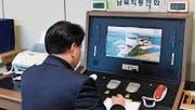Seit gestern wieder in Betrieb: das rote Telefon in Panmunjeom, einer Einrichtung in der demilitarisierten Zone (DMZ) zwischen Nord- und Südkorea. (Bild: Vereinigungsministerium/EPA (3. Januar 2018))