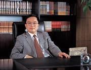 Der chinesische Geschäftsmann Guan Jianzhong. (Bild: AFP (7. August 2010))