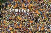 Appetit auf Separation: Katalanen schwenken Fahnen für ihre Unabhängigkeit. (Bild: David Ramos/Getty (Barcelona, 11. September 2017))