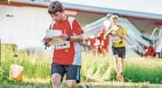 Zwei junge OL-Sportler am letztjährigen Lauf in Hüttwilen. (Bild: PD (27. Mai 2016))