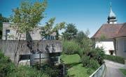 Mehr als bloss ein Provisorium: In idyllisches Grün gebettetes Sterbehospiz direkt neben der Heiligkreuz-Kirche in St. Gallen. (Bild: Ralph Ribi)