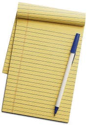 Yellow line notepad with pen on top isolated on a white background. (Bild: Andreas Stock)