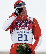 Tränen des Glücks: Dario Cologna nach seinem Triumph im Skiathlon in Sotschi. Heute führt der dreifache Olympiasieger die Schweizer Delegation als Fahnenträger an. (Bild: Peter Klaunzer/KEY)
