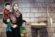 In der Ausstellung kann man fünf Menschen auf der Flucht begleiten – zum Beispiel die Syrerin Hayat. Sie ist mit ihren Kindern nach Libanon geflohen, wo sie in einer versifften Garage Unterschlupf gefunden hat. (Bild: Manuel Lopez/KEY (Zürich, 27. Oktober 2016))