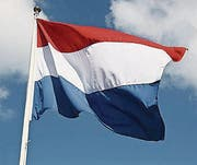 Dutch national flag on liberty day against blue sky with clouds (Bild: (79790892))