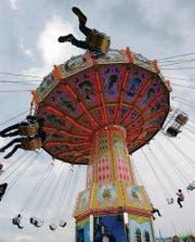 In luftiger Höhe: Der Fliehkraft ausgesetzt im Riesenkarussell.