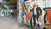 Marx lebt – nicht nur in etwas schummrigen Unterführungen wie hier in Berlin.