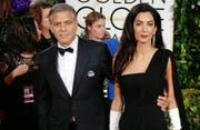 George Clooney mit Amal Clooney (Bild: Hubert Boesl (dpa))