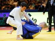 Evelyne Tschopp (in weiss) holte in Tel Aviv zum zweiten Mal eine Bronzemedaille an Europameisterschaften. Hier besiegt Tschopp die Norwegerin Madelene Rubinstein (Bild: KEYSTONE/EPA/ABIR SULTAN)