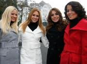 «Wir verstehen uns wie vier dicke Freundinnen» (v.l.): Christa Rigozzi, Jannifer Ann Gerbber, Amanda Ammann und Whitney Toyloy vor dem Park Hotel in Weggis. (Bild André Häfliger/Neue LZ)