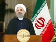 Der iranische Präsident Hassan Ruhani lehnt eine Neuverhandlung des Atomabkommen kategorisch ab. (Bild: KEYSTONE/PETER KLAUNZER)