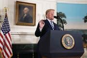 Donald Trump verkündet bei einer Ansprache im Weissen Haus den Ausstieg der USA aus dem Atomabkommen mit Iran. (Bild: Evan Vucci/AP (Washington, 8. Mai 2018))