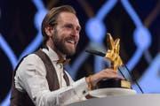 Zum zweiten Mal ging ein Walo an Kunz. 2012 erhielt er die Auszeichnung als bester Newcomer, in diesem Jahr nun in der Kategorie Pop/Rock. (Bild: Patrick Hürlimann / Keystone (Zürich, 14. Mai 2018))