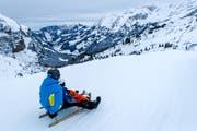 Wintersportler auf dem Schlitten. (Bild PD)
