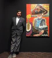 André Wilhlem vor einem seiner Bilder. (Bild: PD)