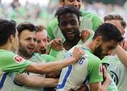 Lernt nun Holstein Kiel kennen: Wolfsburg-Stürmer Divock Origi (Mitte). (Bild: Focke Strangmann/Keystone (Wolfsburg, 12. Mai 2018)).