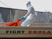 Die WHO erhöht die Ebola-Warnstufe im Kongo und erwägt die Ausrufung eines internationalen Gesundheitsnotstands. (Bild: KEYSTONE/EPA/AHMED JALLANZO)