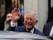 Prinz Charles führt Meghan Markle bei ihrer Hochzeit mit Prinz Harry zum Altar. (Bild: KEYSTONE/AP/PETROS GIANNAKOURIS)