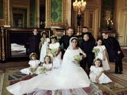 Das Brautpaar mit den Kindern, die Meghan in die Kirche begleiteten. (Bild: KEYSTONE/AP PA/ALEXI LUBOMIRSKI)