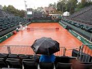 Der Regen verhindert in Genf vorerst den Auftritt von Stan Wawrinka (Bild: KEYSTONE/AP Keystone/SALVATORE DI NOLFI)