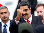 Nach der umstrittenen Wiederwahl des venezolanischen Präsidenten Nicolas Maduro erwägt auch die EU Sanktionen gegen Venezuela. Maduro verwies den US-Botschafter aus Venezuela, nachdem die USA ihre Sanktionen verschärften. (Foto: Ariana Cubillos/AP) (Bild: KEYSTONE/AP/ARIANA CUBILLOS)