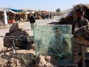 Von Nato-Truppen ausgebildete afghanische Sicherheitskräfte in der Region Helmand: Die USA haben ihr militärisches Vorgehen verstärkt, doch bisher ohne nennenswerten Erfolg. (Bild: KEYSTONE/EPA/WATAN YAR)