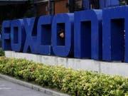 Apple-Zulieferer Foxconn plant grössten Börsengang in China seit drei Jahren. (Bild: Keystone/AP/Kin Cheung)