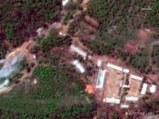 Das nordkoreanische Atomtestgelände Punggye Ri in einer Luftaugfnahme. Das Gelände wurde von Nordkorea laut Medienberichten unbrauchbar gemacht. (Bild: Keystone/AP/)