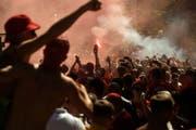 Supporter vor dem Champions League Final zwischen Real Madrid und Liverpool. Bild: AP Photo/Andrew Kravchenko