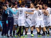 Nicola Portner jubelt mit seinen Kollegen von Montpellier über den Gewinn der Champions League (Bild: KEYSTONE/EPA EFE/TONI ALBIR)